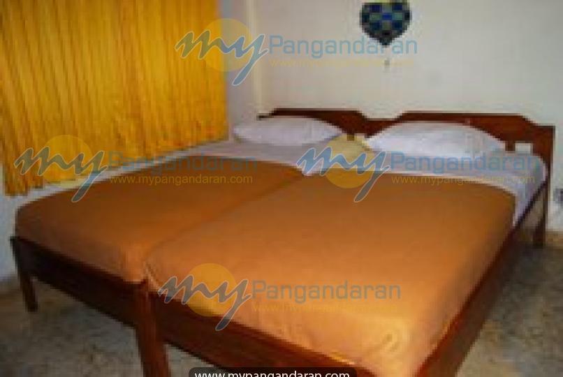 Tampilan kamar tidur Melia Beach Hotel